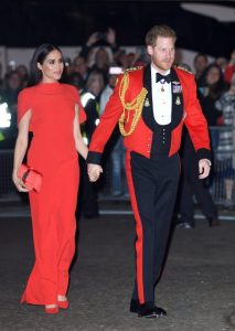 Meghan Markle is Radiant in Red Caped Gown at Mountbatten Festival of Music